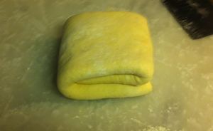 Flipping the dough, so that the fold is on the bottom